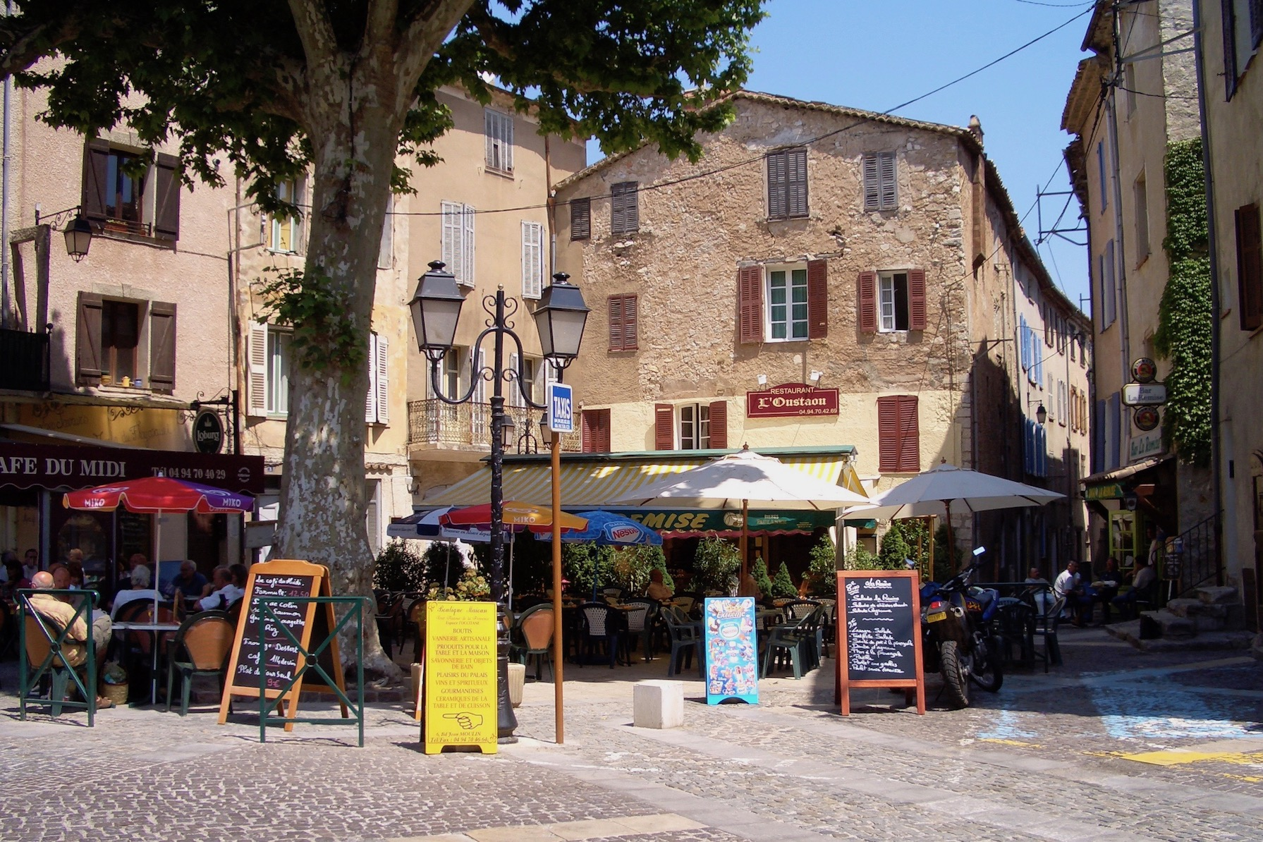 Several restaurants in the square in front of the house